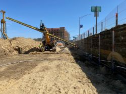 Drill Tech drilling tiebacks in shoring wall
