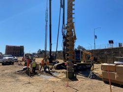 Drilling auger cast test piles at the LPR Site
