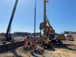 Drill Tech drilling piles for building foundation at LPR Site