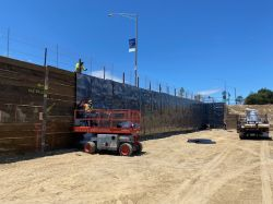 Installation of below grade waterproofing at shoring wall