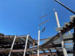 Crane Erecting Steel at Roof
