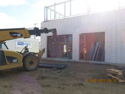 Installing overhead coiling door frames