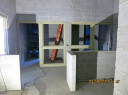 CMU Block Wall installation in the detention area