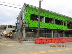 Installing Exterior Drywall at Building Exterior