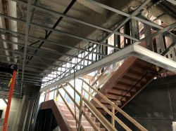 Framing ceiling soffits at South Stairs in Police Building
