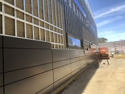 Install metal panels at Police Building Exterior