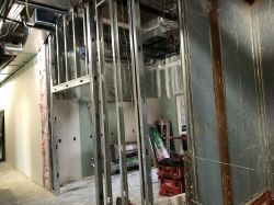 Framing walls in Kitchen Room 2303 and front of Elevator 2