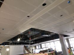 Taping ceiling soffits in Patrol Room 1306