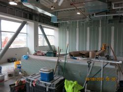 Taping drywall in Services Division Room