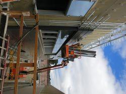 Installing exterior metal panels