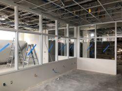 Install interior glazing in Room 1309