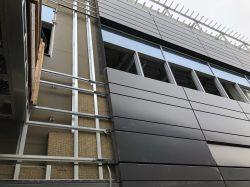 Install exterior metal panel