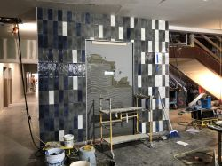 Install wall tiles in Room 1306