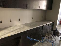 Install countertop in Room 2303