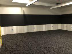 Preparing to install wall panels at Squad Briefing